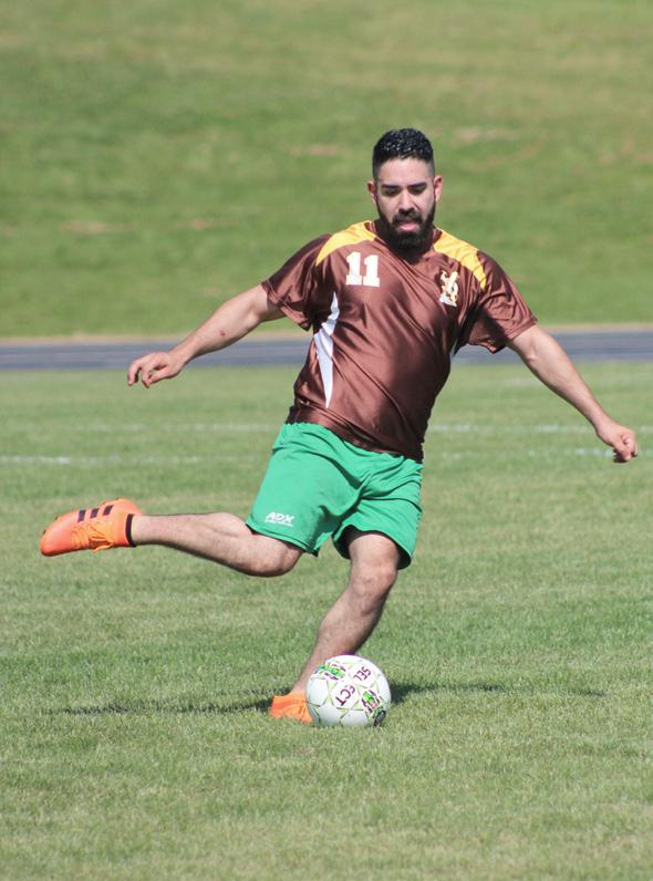 a man kicking a soccer ball at the 2019 hilltopper