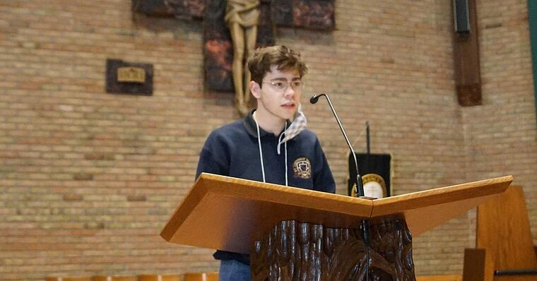 a student speaking at mass