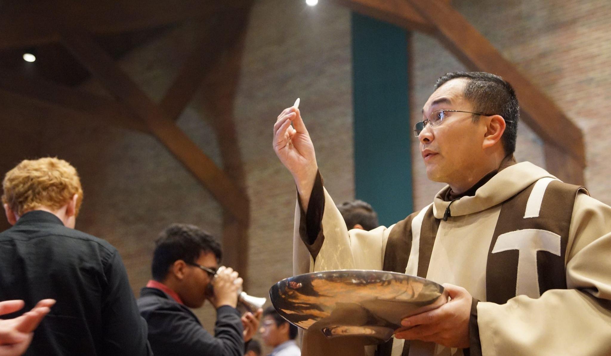 Fr. Zoy leading communion