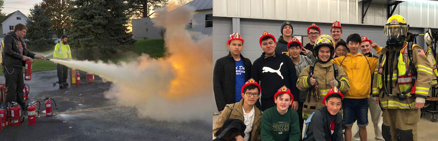 students putting out a fire and posing with firefighters