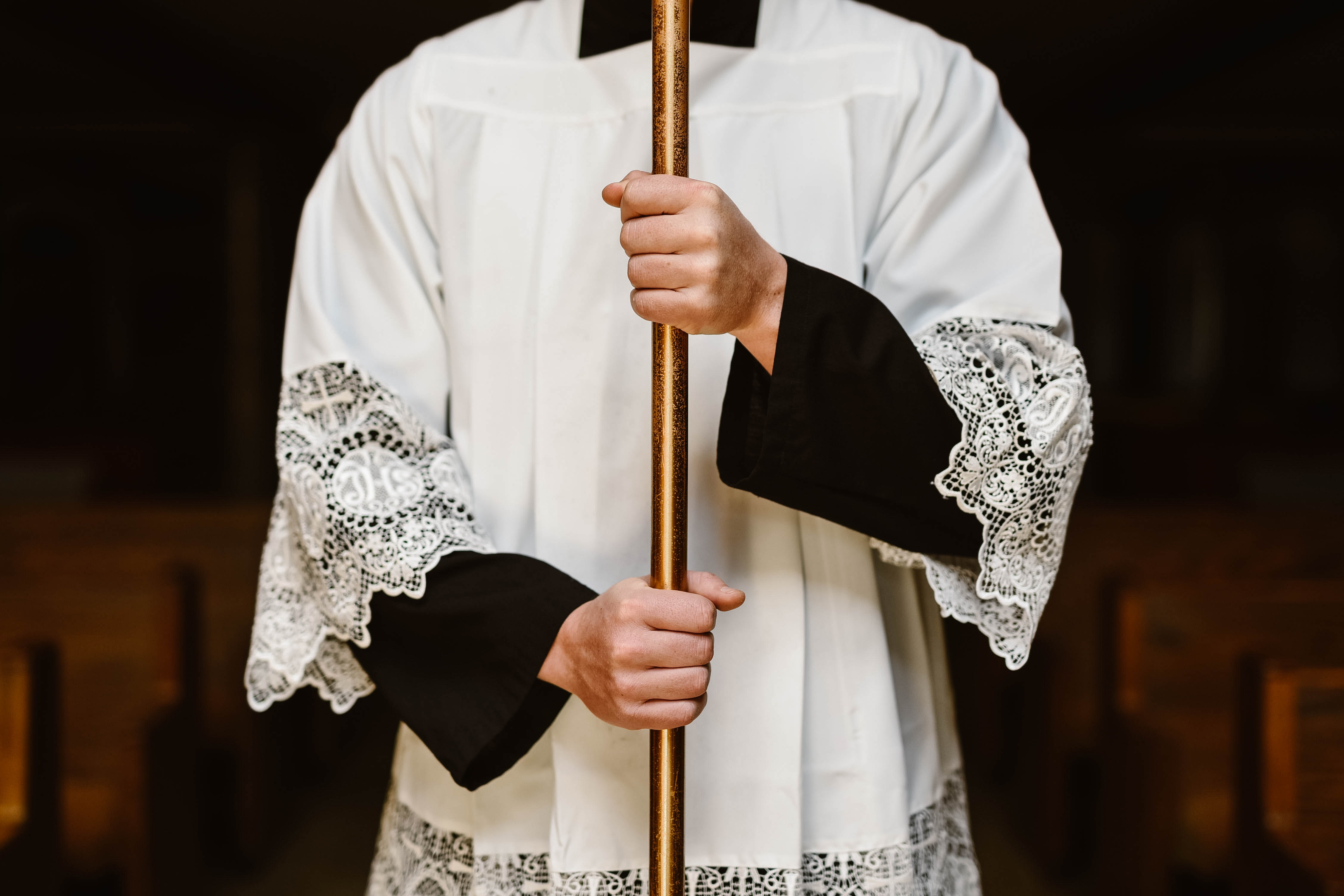 a catholic in a robe holding a staff